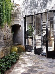 Outdoor design: architecture, old stonework, folding french doors and greens! Steel Windows, Windows And Doors, Interior Exterior, Exterior Design, Exterior Doors, Outdoor Rooms, Outdoor Living, Indoor Outdoor, Casa Patio