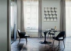 Knoll Saarinen Tulip dining table - black base marble top modern