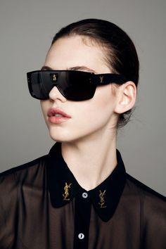 black sheer shirt and YSL brooches