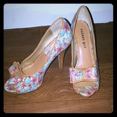 Madden Girl peep toe pumps Peep toe pumps floral pattern with pastel colors. Only scuff mark on one shoe shown on the last picture. Madden Girl Shoes Heels