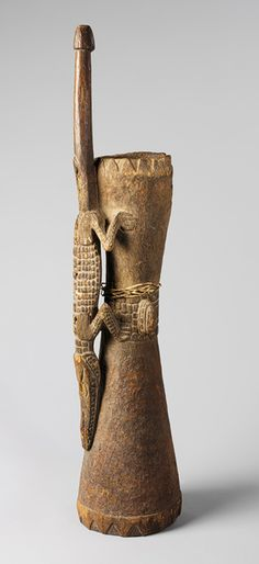 Water Drum by the Iatmul people from Papua New Guinea, Middle Sepik region, Mindimbit village, 19th-early 20th century. Wood and fibre | Metropolitan Museum of Art