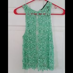 """⬇️REDUCED❗️HP 6/15 LF Floral, Open Back Tank REPOSH This top is NWT! However, all size and care tags were removed before I purchased it. I would say it would fit an xs. It is a mint green color. It is approximately 17"""" across the bust when laid flat and 22"""" from shoulder to hem. Tag attached says Poof Apparel. LF Tops Tank Tops"""