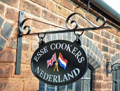 Parisian Blacksmith Shop Sign Bracket - The wrought black iron parisian Shop Sign Bracket has a black finish and not only looks great but is also fully functional as a bracket to hang a sign from. House Name Signs, Pot Hanger, Old Pub, Blacksmith Shop, Shop Fronts, Outdoor Signs, Store Signs, Retail Shop, Blacksmithing
