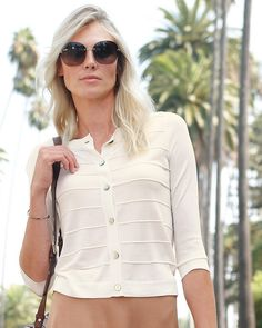 Choose from either a featherweight cashmere cardigan (that you can wrap around your shoulders), or a cropped linen cotton cardigan that's light enough in fabric and style for summertime wear.