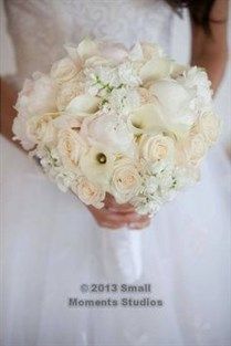 A soft white bouquet of peonies, roses and hydrangeas looks lush.