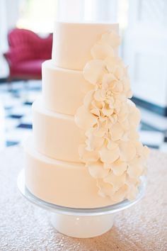 Classic Wedding Cake With Cascading Sugar Flowers. Could do the flowers in whatever your color scheme is. Blush maybe?