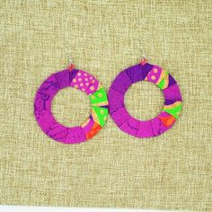 $9.99 Kitenge Fabric Hoop Earrings--These earrings were handmade by wrapping colorful African kitenge fabric around an aluminum base. They are very lightweight considering the size. Each pair of hoop earrings is as unique as the cut of fabric that was used.