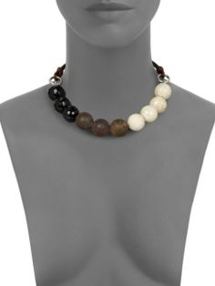 Brunello Cucinelli - Beaded Necklace . black agate , river stone , bronzite beads . bold polished stone beads suspended by leather cords . http://www.saksfifthavenue.com/main/ProductDetail.jsp?PRODUCT<>prd_id=845524446658711
