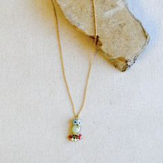 MARIANNE NECKLACE  Item #PN171  A splash of own whimsy on the perfect delicate chain.  18″ – 22.5″ adj.  $14