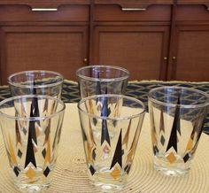 Six Vintage Atomic Pattern Barware Mid Century Mod Rock Glasses. $30.00, via Etsy.