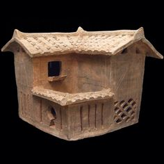 A Rare Early Eastern Han Stoneware Farm House. From a Kiln in Guangzhou Province, Han Dynasty c.25-75 A.D. The L-Shaped Farm House is of 'Pile-Structure' Type with a Rectangular Hall in Front and a Yard at the Back with a Sow Suckling Her Piglets While the Male Pig Stands Near. The Tiled Roof and the Wooden Structure are Indicated by Incised Lines. Figures can be Seen Inside the Building, They Show People Working, Probably Preparing Grain, a Dog Stands at the Entrance.