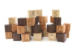 Deluxe ABC 123 Blocks  These gorgeous blocks are made from quality Walnut, Maple, and Cherry woods. They are a beautiful toy that can be passed down from your children to your grandchildren. Learn letters, sounds, pictures, words, stacking, patterns, and spelling with this high quality block set. These will surely become a family heirloom toy.  •Specifications:  -Blocks are permanently engraved on both front and back sides: Upper case letter front with corresponding picture on back of 26…
