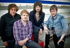 Ian Matthews, Christopher Edwards, Sergio Pizzorno and Tom Meighan pose outside Studio 104 at Album de la Semaine Show at Studio 104 on August 31, 2011 in Paris, France.