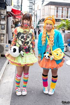 Mow and Ashiyan are two friendly girls we met on the street in Harajuku not far from the #6%DOKIDOKI shop. Their colorful looks include tulle skirts, rainbow socks, cute sneakers & panda purses. #tokyofashion #street snap #Harajuku