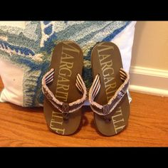 Flip flops Comfy casual beach flip flops MARGARITAVILLE BRAND. Worn a few times very clean, Look great with cutoff shorts & tank top. Khaki in color Margarita-ville Shoes Sandals