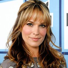 Dimensional auburn with blond highlights on Molly Sims.