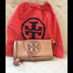 Tory Burch perforated wallet w/ straps Rose gold/metallic wallet perfect for going out! Can be used as a clutch, wallet, or cross body. NWOT price negotiable comes with Tory burch wallet case Tory Burch Bags Wallets