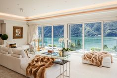 Nestled next to Lake Lugano and the mountains, the penthouse's expansive windows and minimal furniture allow for the homeowners and guests to take in the breathtaking view.