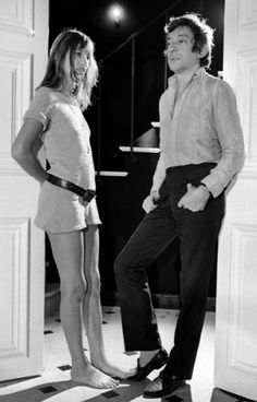 Jane Birkin, in a knitted mini dress and a low-slung belt, with partner Serge Gainsbourg in Paris in 1969.