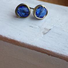 A personal favorite from my Etsy shop https://www.etsy.com/listing/254163059/blue-brass-wrapped-stud-earrings
