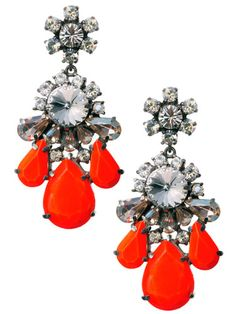Shourouk Earrings: Sparkles are always in holiday Vouge. But the splash of red makes these earrings especially adorable for the holiday.