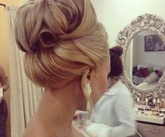 I always love a big, puffy & extravagant bun - all the volume makes it flattering for all face shapes.