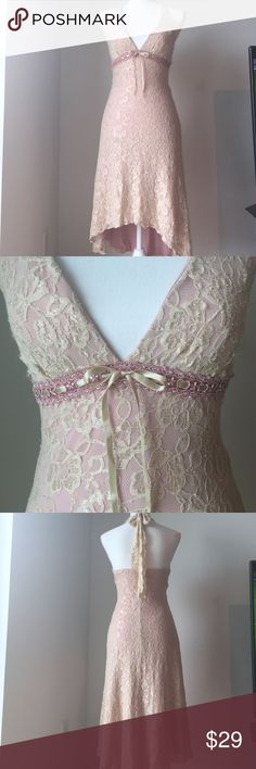 Vintage 1970's Lace Halter Dress This Saucy 1970's Vintage find is so Sweet!❤️ Creamy soft lace High-Low Halter dress with blush pink lining & pink ribbon embellishment under breast area with cute little Tie! Fits like an xs on the Manequin . 13 inches across from armpit to armpit when dress is lying flat. 24 inches long in front of dress from V-neck plunge to hem and 35 inches long in back from same point. Dresses High Low