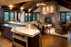 Lighting on the cathedral ceilings ... Notice how the floor board design defines/separates the kitchen/family room spaces