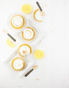 Through rain or shine, these little tartlets are sure to brighten your day with their delicate lemon and ginger curd filling, sweet meringue topping, and graham cracker crust.