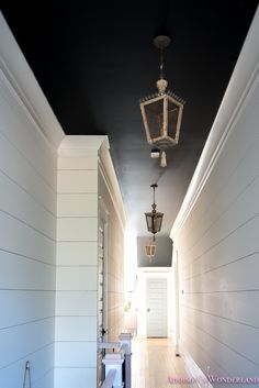 One of my favorite spots in the house. our big ol' hallway reveal! Black Ceiling, Shiplap, Black Wall Lights, White Ceiling, Ship Lap Walls, Blue Ceilings, Whitewashed Hardwood Flooring, White Walls, Blue Hallway