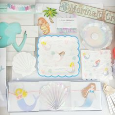 Party Like a Mermaid! To see full descriptions or to order more of an item view our Mermaid Collection on our website: https://pixiedustpartyspot.com/collections/magical-mystical-mermaid-party This fun, mermaid themed party kit includes the following items:  1 Set of Large Mermaid Plates 1 Set of Large Mermaid Napkins 1 Set of Scallop Shell Plates 1 Set of Shell Napkins  Optional Item: Mermaid Garland   Detail of Items: Mermaid Plates: * Feature an underwater world * Merma...