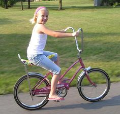 "I had a gold 20"" Schwinn with a pink flowered banana seat and a white wicker basket on the front with flowers on it!"