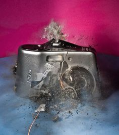 An exploding camera by photographer Alan Sailer #photography