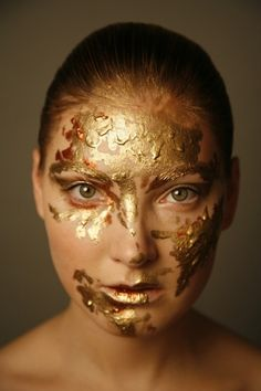 Stunning gold face paint with hints of copper splattered across the face creating this sparkly fantasy creative makeup look. Gold Face Paint, Face Paint Makeup, Dragon Makeup, Musical Hair, Makeup Wallpapers, Gold Makeup, Beauty Shots, Fantasy Makeup, Makeup For Brown Eyes