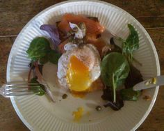 Poached egg, salmon, capers and salad leaves