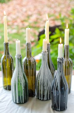 Old bottle (wine bottle) candle holders for a very antique look! Best idea!