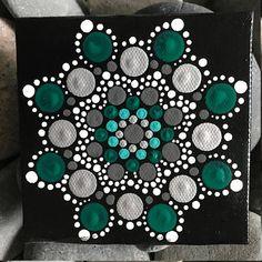 For sale is a hand-painted Mandala on a 4x4 canvas. Painted with high-quality acrylic paints, with a gloss acrylic finish for protection. Colors in this Mandala are Silver, Green and Aqua. Each one is hand made and no two are alike