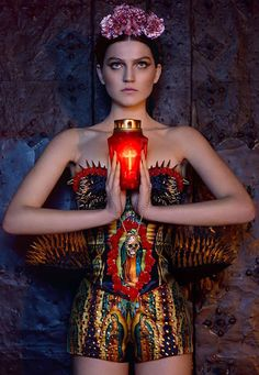 """mikapoka: Frida in H's swan song    """"Frida reloaded"""" is actually a fascinating eye-opener on Mexican style combining iconic features such as its apparently clashing  colors with traditional motifs like skulls or images of the  Virgin Mary through dramatic colorful outfits and pictures."""