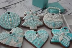 "Beautifully piped, pale aqua Christmas tree, ornaments, hearts, and star gingerbread ornament cookies, ready to hang on the Christmas tree.  So lovely.  Expertly crafted by ""Maybe a Cookie"" and posted at Cookie Connection."