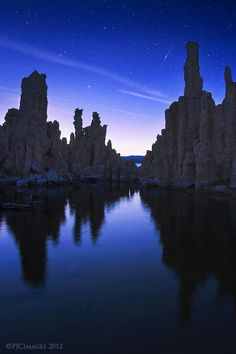 A shooting star glides across the twilight skies above Mono Lake, California