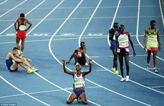 Mo Farah sinks to his knees and points to the heavens after winning the 10,000m, his first of two golds at Rio 2016