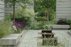 Lovely combo of hard structure/materials with soft planting, by Simon Irvine.