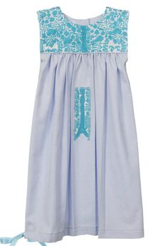 "Mi Golondrina -- Blue Allure Pale blue cotton baby dress with aqua hand embroidered detail. Finished with aqua blue ribbon detail. Measurements: 23.5"" from shoulder to hem, 9.5"""