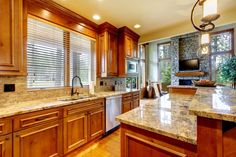Photo about Mountain luxury home with wood kitchen and granite countertop. Image of home, design, interior - 28020660 Cost Of Granite Countertops, How To Install Countertops, Granite Kitchen, Kitchen Countertops, Countertop Paint, Backsplash, Countertop Materials, Kitchen Island, Kitchen Cabinets Color Combination