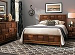 Go with the grain—the alluring Jovie 4-piece queen platform bedroom set showcases the natural characteristics of wood. From the bowed drawer fronts and bed panels that form a basket-weave pattern to the black drawer pulls and boot heel feet, simplicity of design keeps the focus on the velvety walnut grain. Blending rustic and modern with a touch of the exotic, the Jovie queen platform bedroom set offers unique style.