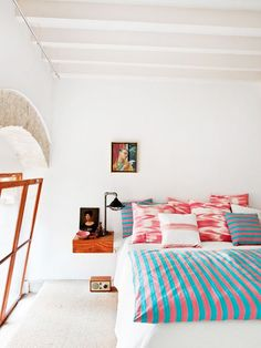 Decorating with color / sfgirlbybay. Teal and coral  guest bedroom color scheme with bright white walls and colorful artwork.