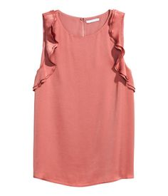 Vintage pink. Sleeveless top in airy woven fabric. Opening at back of neck with button. Double ruffles around armholes. Lined.
