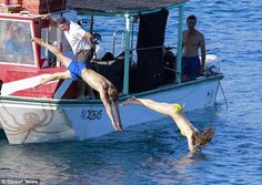Taking the plunge: Jamie and Dakota were filmed diving off the edge of the boat as they re...