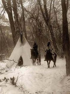 Indians on Horses In Front of Tipi