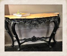Marble topped console table, $495.  Gaslamp Antiques booth B000.